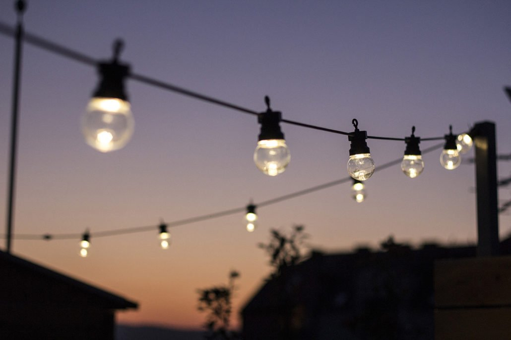Rooftop string lights on sunset
